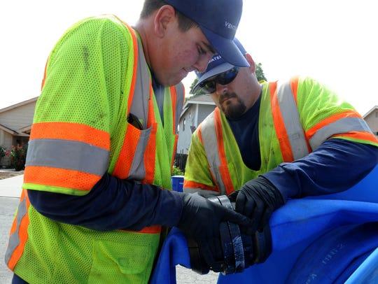 Operators Alexander Gonzales, left, and Brandon Segovia