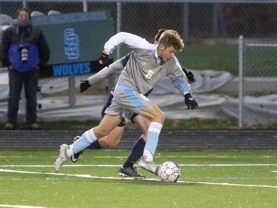 South Burlington senior Josh Coon streaks up the field