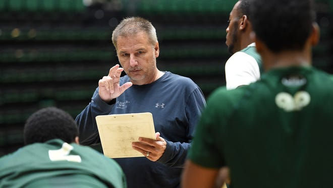 CSU basketball coach Larry Eustachy talks to his players during an October 2015 practice at Moby Arena. Eustachy has relied primarily on transfers to fill his rosters at CSU but said he hopes the success those transfers have had will allow him to recruit more high school players in the future.