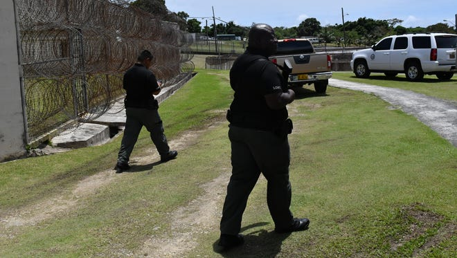 Guam Department of Corrections Officers escort media through a tour of the prison on Sept. 19, 2017.