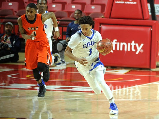 Decatur's Kevon Voyles sprints down the court on a fast break in the MPSSAA 3A state semifinals at the Xfinity Center in College Park on Thursday, March 9, 2017.