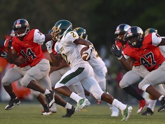Taft's DeMarco Bradley rushes for a first down against Mount Healthy.