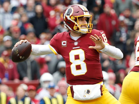 Washington Redskins quarterback Kirk Cousins (8) throws the ball during the first half against the Arizona Cardinals at FedEx Field.