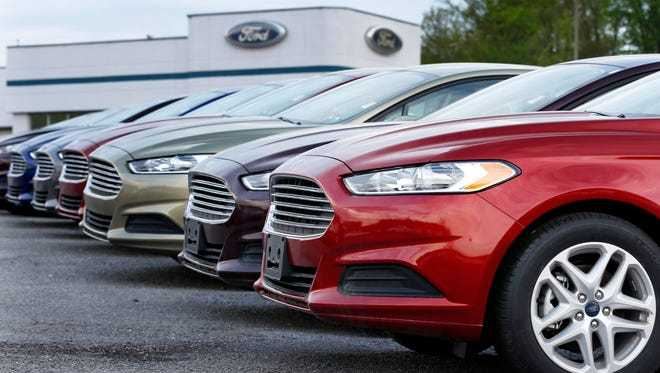A row of new Ford Fusions is seen at an automobile dealership in Zelienople, Pa., in this 2013 file photo