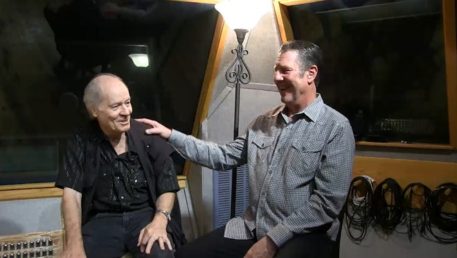 Kenny O'Dell, left, tells Bart Herbison, right, about songwriting.