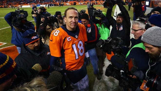 Denver Broncos quarterback Peyton Manning (18) reacts after defeating the Pittsburgh Steelers the AFC Divisional round playoff game at Sports Authority Field at Mile High.
