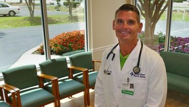 Dr. Brad Hawkins is one of the physicians manning the new Sacred Heart Urgent Care center at 4435 Highway 90 in Pace. He is shown in the patient lobby of the new care center.