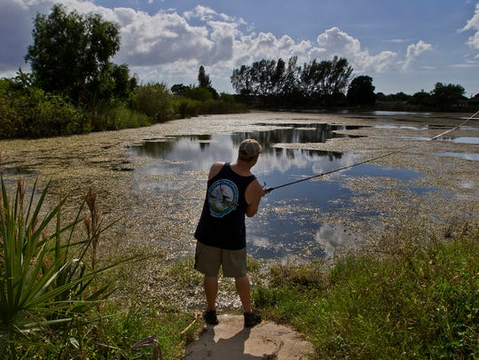 Zack Hudson, of Cape Coral, casts a line while fishing