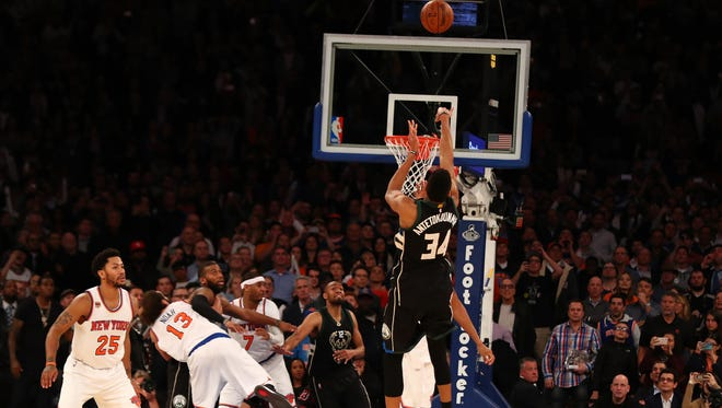 Giannis Antetokounmpo hits the winning basket as time runs out against the New York Knicks.