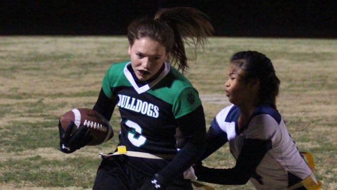 The Lady Bulldogs defeated Cheyenne, 13-6, Monday night in North Las Vegas and followed that up with a convincing 33-13 triumph over Sierra Vista Wednesday night in Las Vegas. Dylan Bryant looks for running room against Spring Valley during a recent game.