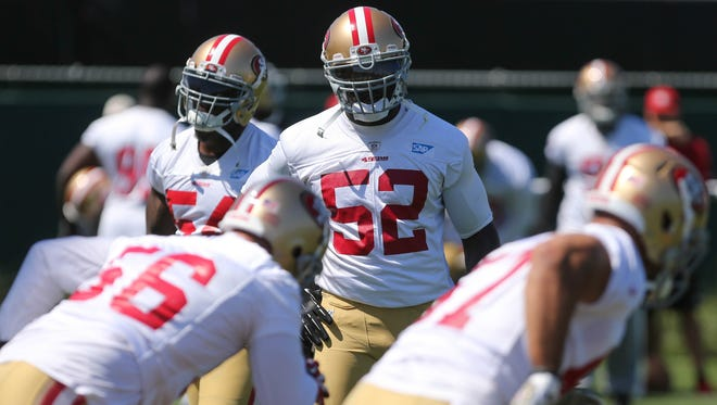 Jun 17, 2014; Santa Clara, CA, USA; San Francisco 49ers inside linebacker Patrick Willis (52) watches drills during minicamp at the 49ers practice facility.