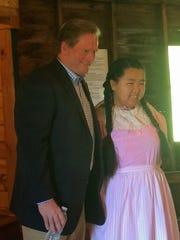 Butler poses with fan Jade Pfeifer, 16, of Random Lake.