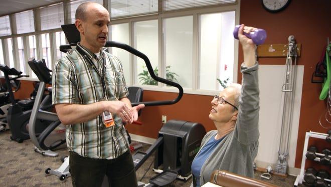 Jeff Eagan, oncology PT program supervisor, instructs Jean Lehmann, a cancer survivor.