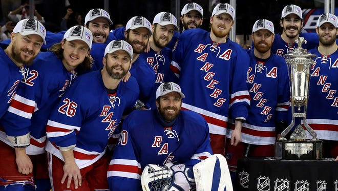 Rangers players pose with the Prince of Wales Trophy after defeating the Montreal Canadiens in Game 6 to win the Eastern Conference final.