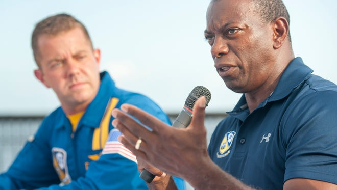 In this archived photo from July 11, 2016, former Pensacola Naval Air Station Commanding Officer and former Lead Solo Keith Hoskins, right, and Blue Angels No. 5 Lt. Ryan Chamberlain answer questions from the public during an event in Pensacola. Blues in the City will resume Wednesday..