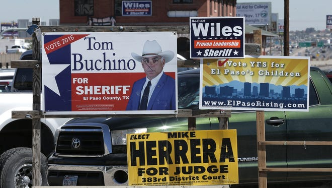 Sheriff's race campaign signs for Tom Buchino and Richard Wiles are posted at the intersection of Campbell Street and Franklin Avenue.