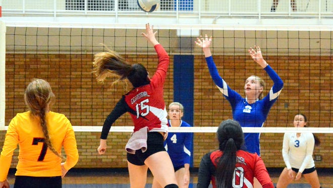 Carlsbad's Carrie Lynn (2) watches Centennial's Raquel Gonzalez tip the ball over the net in the first set Saturday.