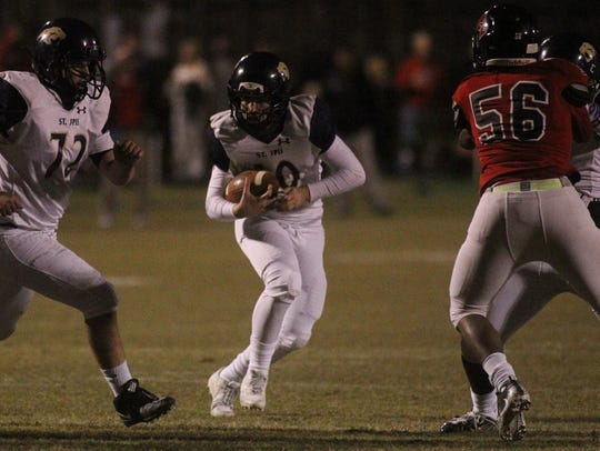 St. John Paul II quarterback Brian Woodend looks for