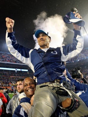 Indianpolis Colts coach Tony Dungy is carried off the field after the Colts' 29-17 victory over the Chicago Bears in Super Bowl XLI on February 4, 2007.