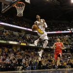Indiana Pacers forward Paul George (24) dunks during an NBA basketball game between the Indiana Pacers and the Los Angeles Clippers in Indianapolis, Saturday, Jan. 18, 2014. The Pacers won 106-92.
