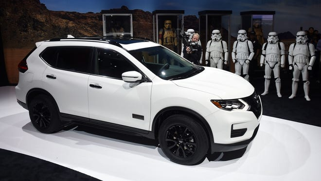 Storm Troopers stand at attention as the 2017 Nissan Rogue 1 Star Wars Limited Edition is unveiled at a press conference during media preview days ahead of the Los Angeles Auto Show.
