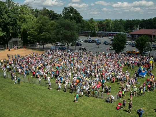 1,127 people simultaneously blow wooden whistles in Chatham Borough.