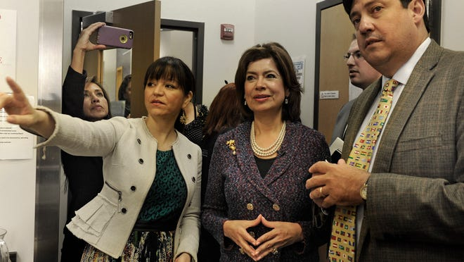 Maria Contreras-Sweet, head of the U.S. Small Business Administration and a member of President Barack Obama's Cabinet, is given a tour by Renata Soto and Jose Gonzalez. Contreras-Sweet visited Nashville to promote the New Americans agenda and meet with local immigrant business owners.