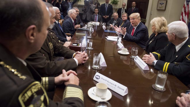 Trump speaks during a meeting with county sheriffs in the Roosevelt Room of the White House.