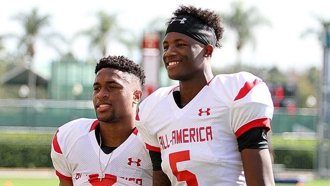Catholic wide receiver Amari Rodgers, left, poses with Oak Ridge wide receiver Tee Higgins during practice for the Under Armour All-America Game in Orlando, Fla. Both players are committed to Clemson.