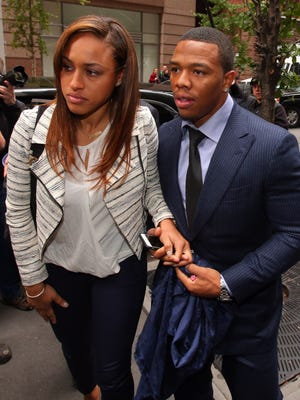 Nov 5, 2014; New York, NY, USA; Suspended NFL running back Ray Rice (right) exits a car with his wife, Janay, to enter the building where Rice will appeal his NFL suspension.