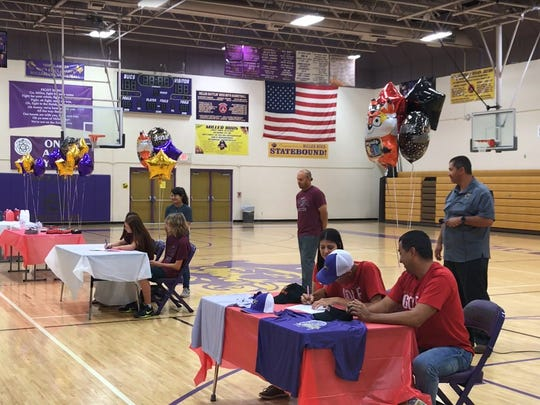 Miller athletes Ethan Barrera (golf) and Kali Shedd (soccer) sign letters of intent on Monday, April 16 at the Miller High School Gymnasium.