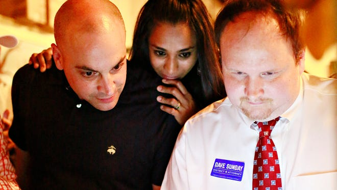 From left, York County District Attorney Dave Sunday, his wife, Lishani Sunday, and campaign manager Joel Ogle anticipate results during a primary election watch party at Central Market in York City, Tuesday, May 16, 2017. Dawn J. Sagert photo