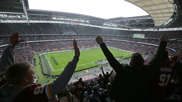 Fans cheer as Washington scores a touchdown in the third quarter of the NFL Week 8 International Series game between Washington and the Cincinnati Bengals at Wembley Stadium in London on Sunday, Oct. 30, 2016. After both teams failed to score in the NFL International Series' first-ever overtime, the game ended in a 27-27 tie.