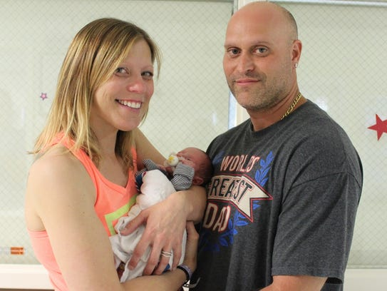 Carlos Guerra and Angela Valente stand with two-week-old
