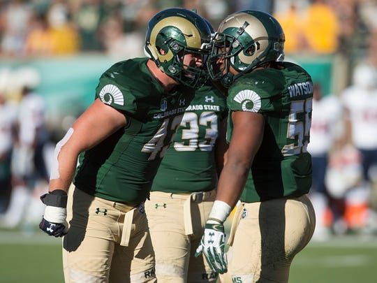 CSU linebackers Evan Colorito and Josh Watson celebrate after a play in a game against UTSA at Hughes Stadium in Fort Collins, Colorado Saturday, September 10, 2016.