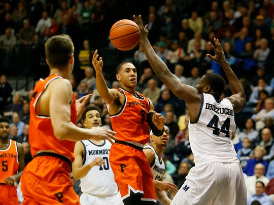 Princeton Tigers guard Devin Cannady (3) passes the