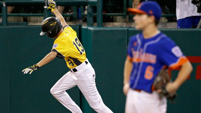 Goodlettsville's Zach McWilliams (19) rounds first after hitting a grand slam off Bowling Green's Drew Wolfram, right, during the fourth inning of the Little League World Series on Aug. 25, 2016.