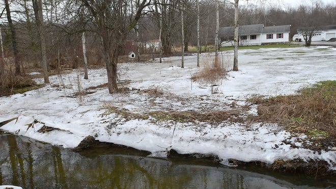 This file photo from February 2019 shows one of the many frozen yards on Mantua Center Road caused by flooding that then froze. Water drains through residents' properties and is collected in drainage ditches, at foreground, that have 8 foot culverts to take the water toward the Black Brook.