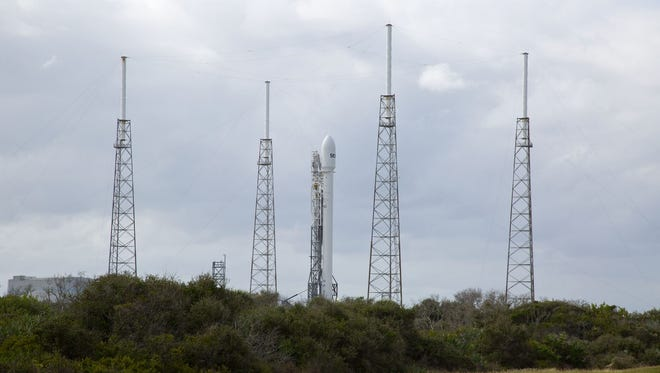 A Falcon-9 rocket is poised on the launch pad at the Cape Canaveral Air Force Station in Cape Canaveral, Fla.