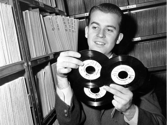Dick Clark selects a 45-record in his station record