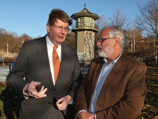 Rober W. Elliott, Sing Sing prison museum board president, left, and Jerry Faiella, project manager, at Louis Engel Waterfront Park in Ossining. Behind them is an abandoned Sing Sing guard tower, which is now in the park.
