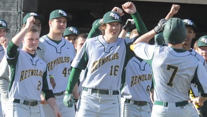 Reynolds' Jon Merrill (7) and Jared Green (44) are members of the Mountain Expos 17U Black baseball team.