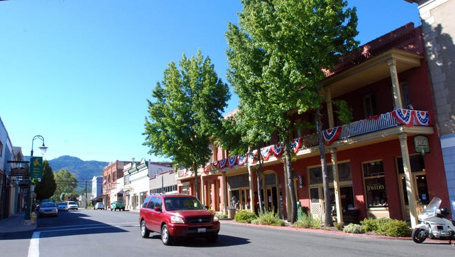 In this Sept. 6, 2013 photo, a car is driven down Miner Street past the historic Franco American Hotel in Yreka, Calif. The former gold mining town served as the temporary capital of a proposed State of Jefferson in 1941 when residents of Southern Oregon and Northern California launched a drive to become their own state. Voters in Del Norte and Tehama counties will decide June 3 on an advisory measure asking each county's board of supervisors to pursue an effort to break away from the state of California.  Elected officials in Glenn, Modoc, Siskiyou and Yuba Counties have already voted to support creating a 51st state named Jefferson. (AP Photo/Jeff Barnard,File)