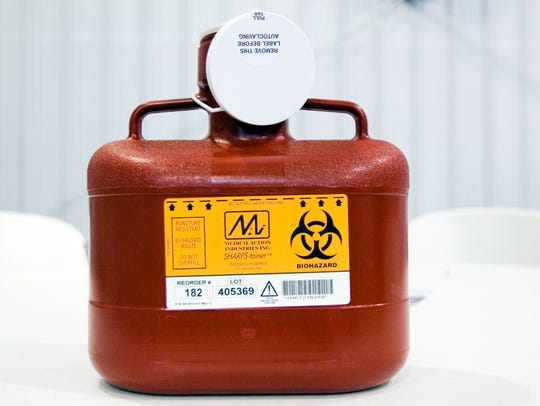 A biohazard container is used for the temporary disposal
