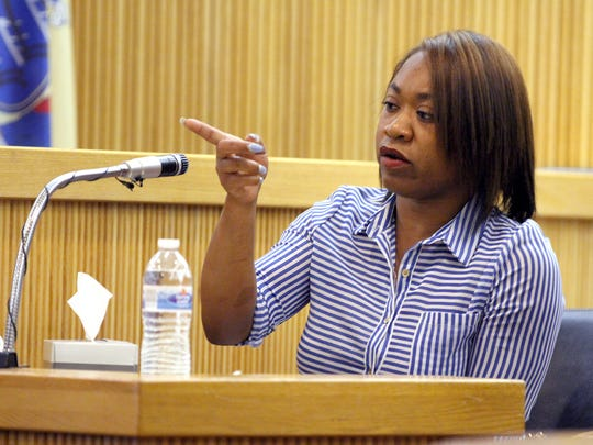Dorothy Brown points to Keith German, the former Asbury Park police officer who went on the lam while on trial with two alleged gang members, during their trial at the Monmouth County Courthouse Wednesday, July 19, 2017.