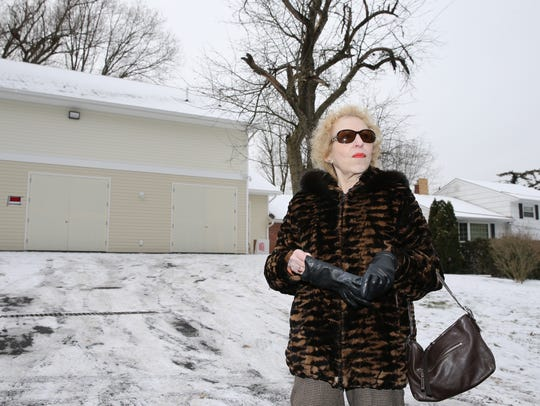 Carole Goodman, 80, whose house borders the property of 3 Spring Hill Terrace in Chestnut Ridge, is bothered by the three-car garage and synagogue on the property. Friday, December 15, 2017.