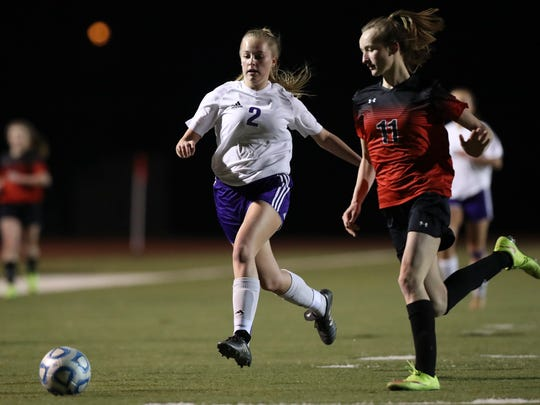 Shasta's Madalyn Peterson moves the ball past Foothill's Grace Dudley during the Wolves' 3-2 win Tuesday night in the Division I semifinal.