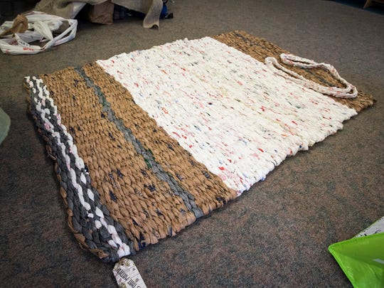 A completed mat constructed out of plastic shopping bags sits on the floor of the Lakeshore Presbyterian Church March 21. The mats are made by Mats That Matter, who makes them out of plastic shopping bags and donates them to the homeless.