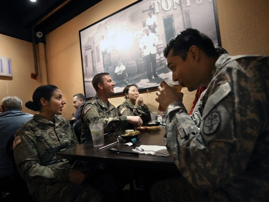 A group of soldiers enjoy lunch at L&J Cafe in Central El Paso. The restaurant was named Best Tex-Mex in the state in a USA TODAY reader contest.