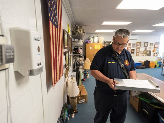 Kimball Township Fire Chief Ed Gratz inspects extension